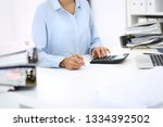 unknown female bookkeeper or... | Shutterstock . vector #1334392502