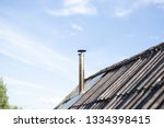 the pipe on the roof. chimney.... | Shutterstock . vector #1334398415