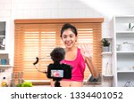 asian woman blogger recording a ... | Shutterstock . vector #1334401052