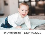 happy baby boy 1 year old... | Shutterstock . vector #1334402222