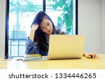 young asian woman with... | Shutterstock . vector #1334446265