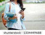 student girl holding books and... | Shutterstock . vector #1334449688