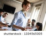 group of young businesspeople... | Shutterstock . vector #1334565305