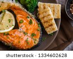 roasted salmon fish steak with... | Shutterstock . vector #1334602628