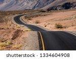 desert road in the amazing... | Shutterstock . vector #1334604908