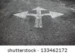 A three way arrow symbol on a...