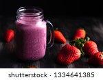 fresh strawberry milkshake | Shutterstock . vector #1334641385
