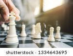 business man with chess board... | Shutterstock . vector #1334643695