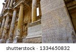 Small photo of Greek inscription in Celsus Library at Ephesus ancient Greek city on the coast of Ionia, Turkey