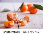 peeled mandarins and zest on... | Shutterstock . vector #1334797712