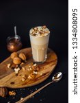 hot walnut coffee  nuts and... | Shutterstock . vector #1334808095