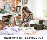 young woman booking a last... | Shutterstock . vector #1334822705