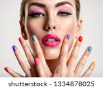 beautiful fashion woman with a... | Shutterstock . vector #1334878025