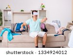 young man husband ironing at... | Shutterstock . vector #1334924012