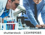 group of scientists wearing lab ... | Shutterstock . vector #1334989085