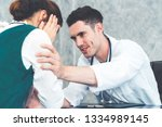 young doctor examining female...   Shutterstock . vector #1334989145