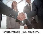 close up.reliable handshake of... | Shutterstock . vector #1335025292