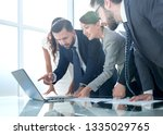business team discusses the... | Shutterstock . vector #1335029765