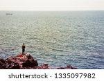 the rocks on the seashore   Shutterstock . vector #1335097982