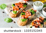 tomato and cheese fresh made... | Shutterstock . vector #1335152345
