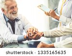 senior male doctor talking to...   Shutterstock . vector #1335165635