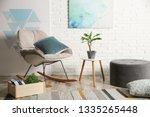 comfortable rocking chair near... | Shutterstock . vector #1335265448