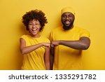 studio shot of overjoyed... | Shutterstock . vector #1335291782