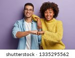 Young Diverse Couple Give Fist...