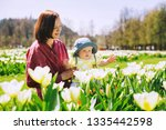loving mother and baby girl... | Shutterstock . vector #1335442598