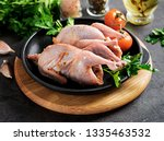 raw uncooked quail. ingredients ... | Shutterstock . vector #1335463532