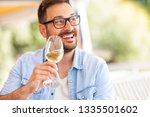 drunk happy man enjoy in wine ... | Shutterstock . vector #1335501602