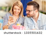 couple interested in looking at ... | Shutterstock . vector #1335501632