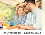 cute couple laughing spending... | Shutterstock . vector #1335501635