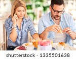 busy woman have  breakfast... | Shutterstock . vector #1335501638