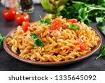 pasta fusilli  with tomatoes ... | Shutterstock . vector #1335645092