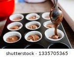 chocolate cupcakes. homemade...   Shutterstock . vector #1335705365