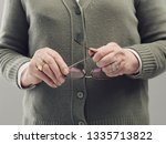 senior lady hands holding... | Shutterstock . vector #1335713822