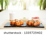 fried hot roll with salmon ... | Shutterstock . vector #1335725402