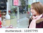 teenage girl window shopping on ... | Shutterstock . vector #13357795