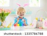 kids dyeing easter eggs.... | Shutterstock . vector #1335786788