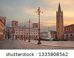 Forli, Emilia-Romagna, Italy: cityscape of the main square Aurelio Saffi with the ancient abbey of San Mercuriale and the post office building of 1932