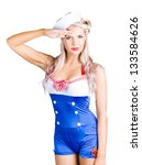 Small photo of Isolated portrait of a beautiful blond american pin-up girl sailor saluting with a Yes Sir on white background