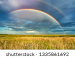 rainbow over stormy sky. rural... | Shutterstock . vector #1335861692