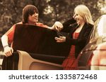 happy young man and woman with...   Shutterstock . vector #1335872468