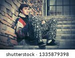 sad young hipster man sitting...   Shutterstock . vector #1335879398