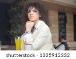 young businesswoman having a... | Shutterstock . vector #1335912332