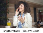 young businesswoman having a... | Shutterstock . vector #1335912335