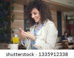 young businesswoman having a... | Shutterstock . vector #1335912338