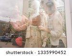 two girls dress up mannequin at ... | Shutterstock . vector #1335990452
