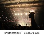 shot of some fans during a life ... | Shutterstock . vector #133601138